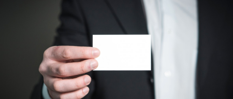 Image of a hand holding a business card